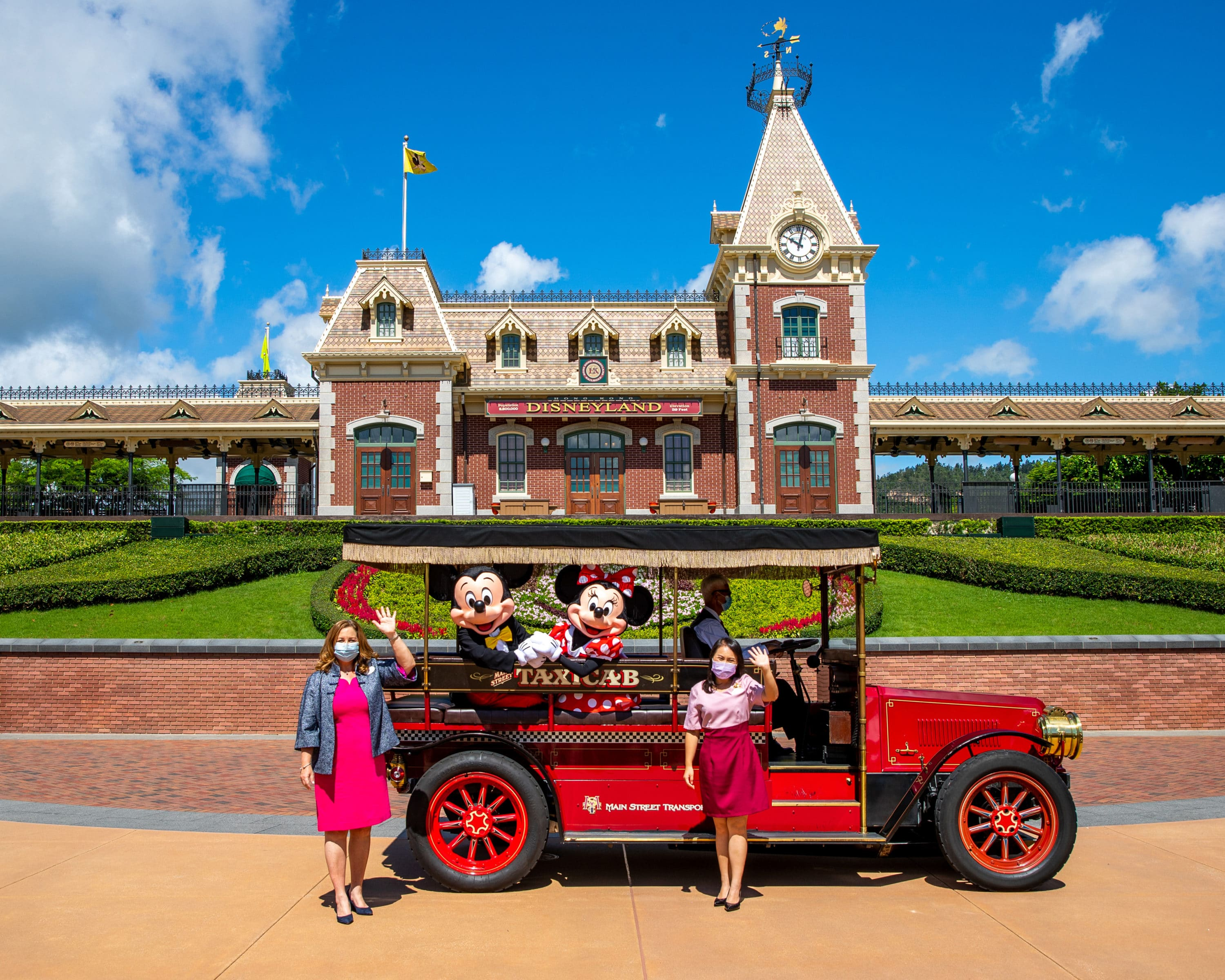 Mickey and Minnie welcome guests back to Hong Kong Disneyland.