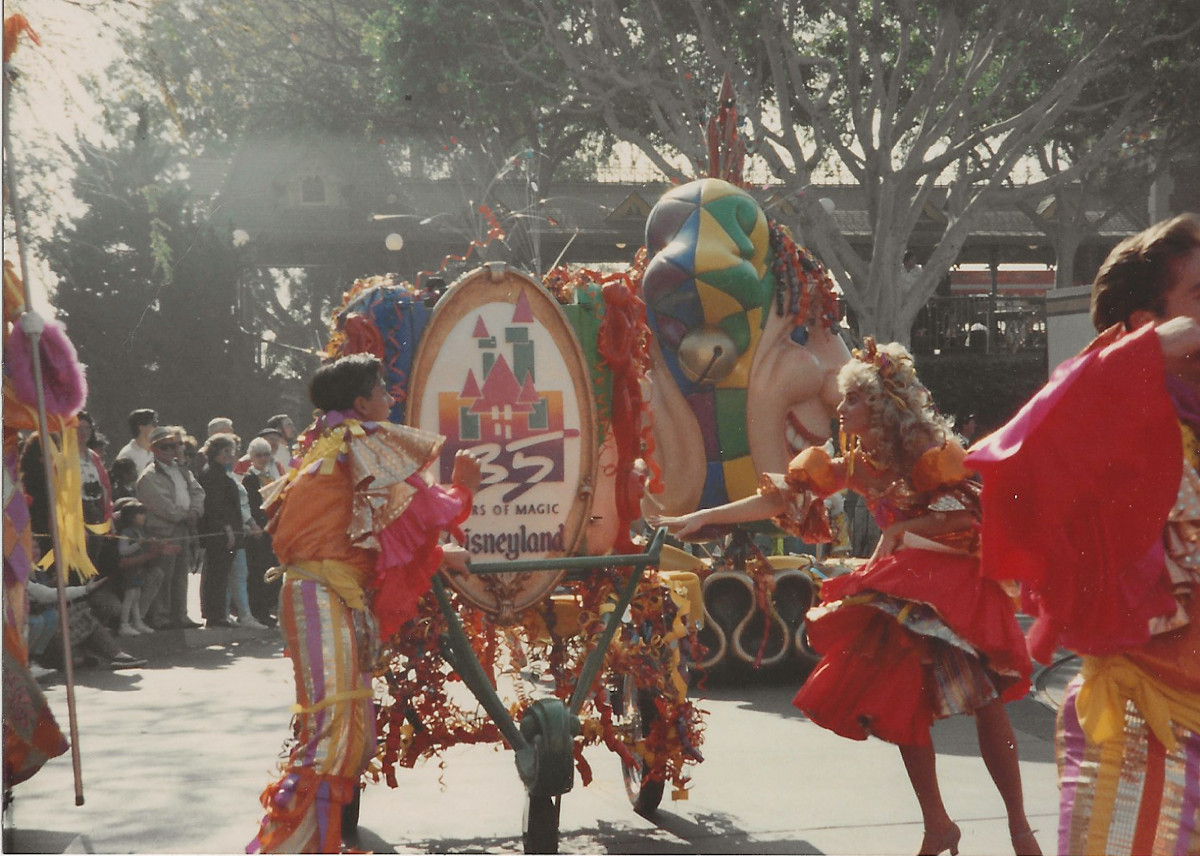 The color scheme for Party Gras was inspired by the 35 Years of Magic logo. (Or was it the other way around?)